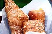 Breakfast table in garden Cinque Terre Italy. Basket of buns.