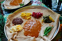 Injera made of tef and served on a big plate with different kinds of vegetables, Ethiopia, East Africa.