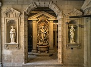 Classical statues in the court of an old palace downtown Milan, Lombardy, Italy