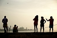 Visitiors enjoying the view of Havana´s Malecón and skyline from the fort accross the bay.