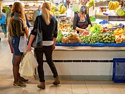 -Young Women Shopping in Market- Alicante Spain.