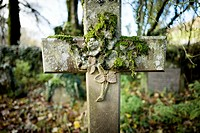 Close-up of a cross with flowers embossed on the stone. Arncliffe Church, Arncliffe, Skipton, Yorkshire Dales, North Yorkshire, England, UK, Europe.