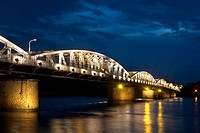 Illuminated Trang Tien Bridge over Perfume River, Hue, Vietnam. Bridge lit up at dusk, Trang Tien Bridge, Perfume River, Hue, Vietnam.
