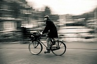 Biking in a bridge over canal in Amsterdam, The Netherlands