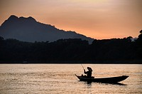 Asia. South-East Asia. Laos. Province of Luang Prabang, city of Luang Prabang, World heritage of UNESCO since 1995. Fisherman on Mekong river.