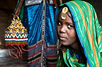 Bride to be. She belongs to the Afar tribe. At Berahile ( Afar state, Ethiopia). Once married, she will become the third wife of her husband in a poly...