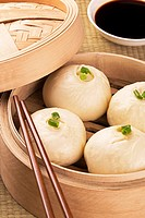 Traditional Chinese meal of baozi also known as dim sun with soy sauce.