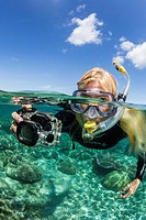 Underwater photographer on coral reef, Pulau Lintang Island, Anambas Archipelago, Indonesia.