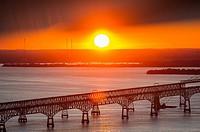 Sunset behind the Chesapeake Bay Bridge in Maryland.