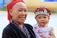 Portrait of smiling Red Dao woman and child, Sapa Surroundings, Vietnam, Asia.