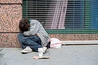New York, USA. Homeless man sleeping in the streets of down town Manhattan.