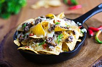 Nachos with haggis, melted cheese and chilli peppers.
