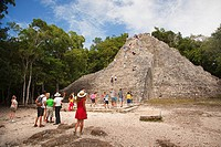 Tourists climbing up to the Nohoch Mul Pyramid at the Prehispanic Mayan city of Coba Archaeological Site, Quintana Roo, Yucatan Province, Mexico, Cent...