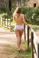 Young woman walking in the forest road in underwear, Alboy, Genoves, Valencia, Spain, Europe