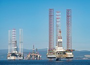 Oil rigs / drilling platforms moored in Cromarty Firth in Ross and Cromarty, Highland, Scotland, United Kingdom.