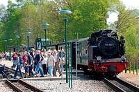 Passenger leave the train Rasender Roland on Ruegen, Germany.