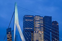 Netherlands, Rotterdam, Erasmusbrug bridge and new commerical towers at the renovated docklands, dawn.