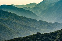 Mutianyu, China - Landscape view of the Great Wall of China mountain range. The wall stretches over 6,000 mountainous kilometers east to west across N...