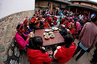 Family and friends having lunch togather for some celebration in Bei people´s village in Dali, yunnan province, china