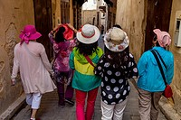 Chinese Tourists Walking In The Medina, Fez el Bali, Fez, Morocco.