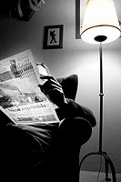 Man reading the newspaper.