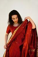 India, Rajasthan, Jaipur, Ishta putting on a sari.