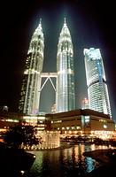 Malaysia, Kuala Lumpur, Kampong Baharu, night time view of the sky bridge linking the two Petronas Towers.