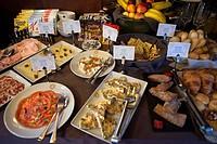 Inside of Transcantabrico Gran Lujo luxury train travellong across northern Spain, Europe. Breakfast buffet.