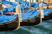 Italy, Venice. Gondolas lined up at dock on the Grand Canal.