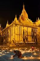 Myanmar, Bagan, Ananda temple, Thadingyut festival of lights, Devotees lighting candles