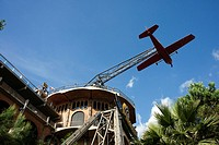 Airplane carousel in Tibidabo Amusement Park, Tibidabo, Barcelona, Spain. The Tibidabo theme park, Barcelona, Spain. Tibidabo is a mountain overlookin...