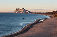 The Rock of Gibraltar (British) and the town of La Linea de la Concepcion seen from the Mediterranean coast north of it. In the background the coastli...