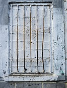 Window boarded up and rusty gate in Monterroso, Lugo