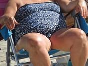 Senior woman sitting in beach chair