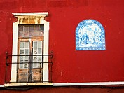 Red house facade in Faro - Algarve region, Portugal