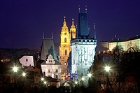 czech republic prague - charles bridge and st. nicolaus church at dusk.