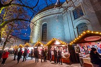 Night view of traditional Christmas Market at St Hedwig's Cathedral at night in Mitte Berlin Germany 2016.