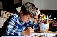 UK, Boy, working on his homework.