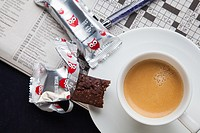 Espresso with healthy cookies and a crossword puzzle.