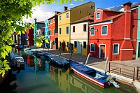 Boat and colored houses in Venetian Burano, Italy.