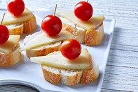 pinchos pintxos manchego cheese with cherry tomatoes from Spain.