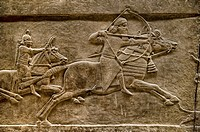 Assyrian relief sculpture panel of Ashurnasirpal lion hunting. From Nineveh North Palace, Iraq, 668-627 B. C. British Museum Assyrian Archaeological e...