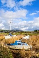Boats on the River Caen at low tide. Braunton, Devon, England.