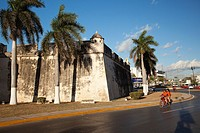 Motorcyclists in front of Baluerte de San Pedro, historic fort at the center of Campeche, Campeche, Yucatan, Mexico, Central America