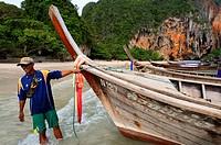 Long tail boat at Happy Island, Hat Phra Nang Beach, Railay, Krabi Province, Thailand, Southeast Asia, Asia. Hat Phra Nang Beach, Railay Beach, forms ...