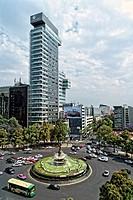 Mexico City, Mexico. Overlooking a Traffic Circle On Paseo de la Reforma, Puente de la Diana Cazodora Monument in the Center. Traffic Going By.