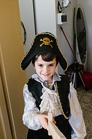 child dressed as a pirate.
