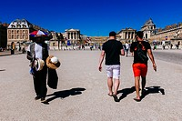 African immigrant selling things to tourists in front of Palace of Versaille main entrance. Versailles, Île-de-France, France.