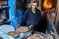 Chefchaouen, Morocco. Baker at Work in his Bakery.