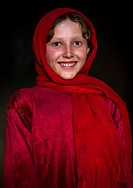 Portrait of an afghan girl with pale skin wearing red clothes, Badakhshan province, Khandood, Afghanistan.